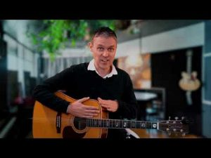 Still image of Patrick tapping polyrthym guitar lesson   Learn Fingerpicking