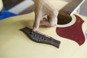 Guitarist changing strings